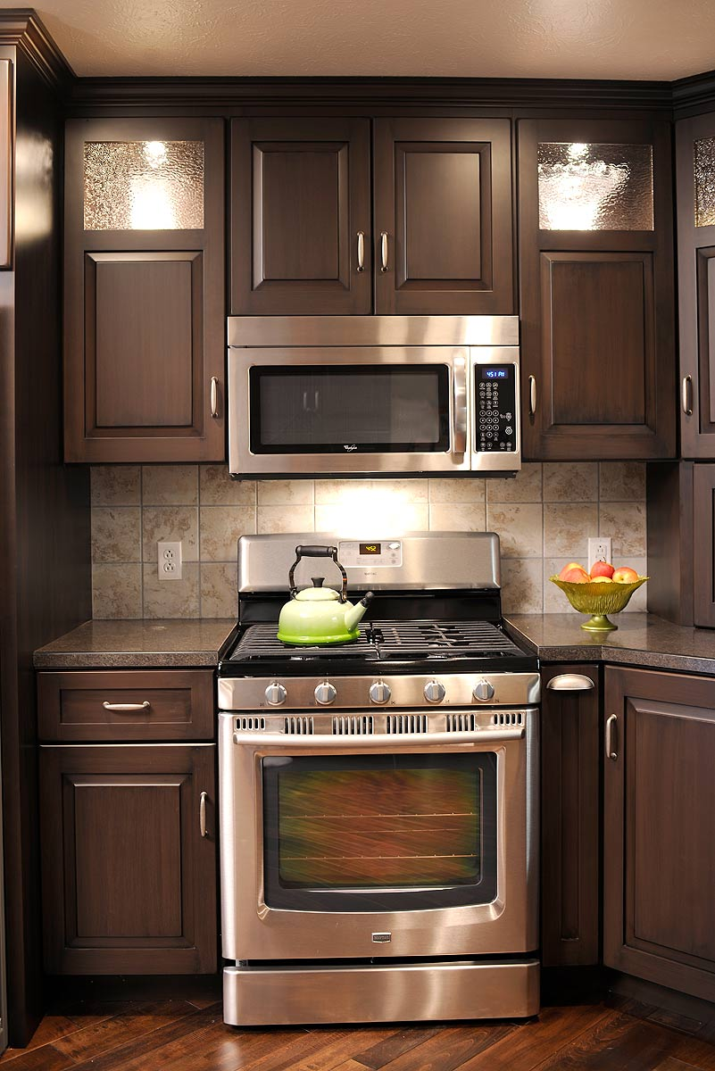 kitchen colors with dark cabinets mullet cabinet brown condominium kitchen 21548
